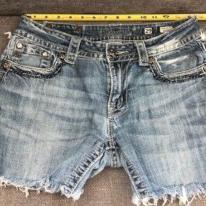 Miss Me Cut off worn jean shorts